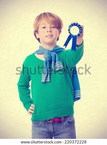 Proud child holding a medal - stock photo