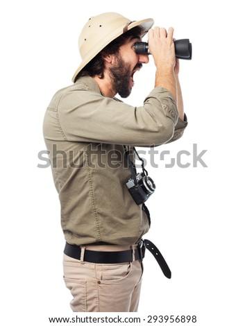 proud explorer man with binoculars - stock photo