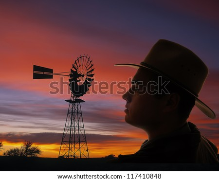 Proud farmer at sunset - stock photo