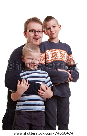 Proud father with two happy sons in his arms - stock photo