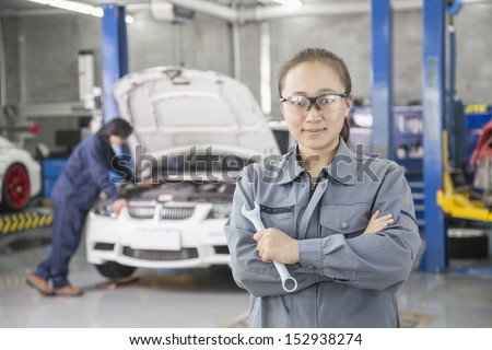 Proud Female Mechanic with Colleague - stock photo