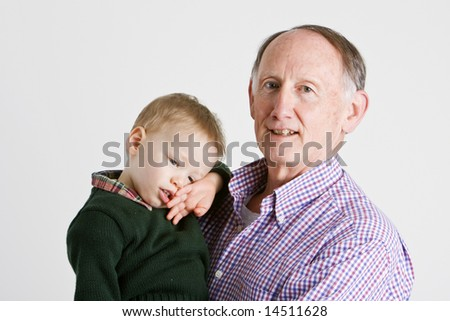 Proud grandfather holding his grandson - stock photo