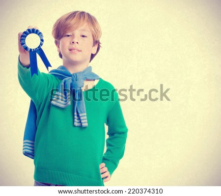 Proud kid holding a medal - stock photo