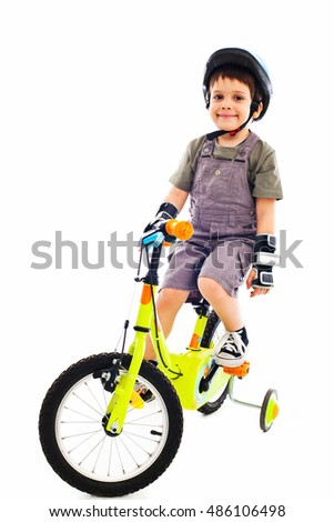 Proud little biker with protective gear
