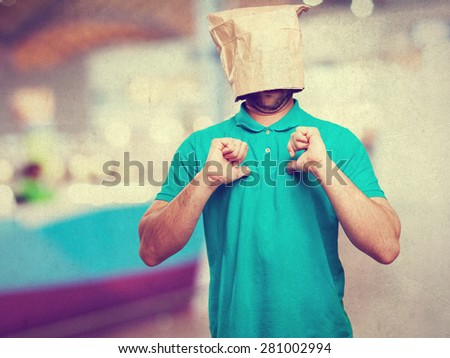 proud man with a paper bag in his head - stock photo