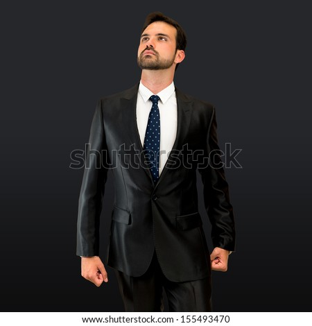 proud of himself entrepreneur over isolated black background  - stock photo