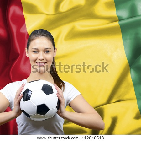Proud woman football fan of Guinea