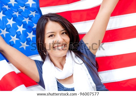 Proud woman with the American flag and smiling