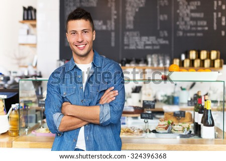 Proud young cafe owner - stock photo