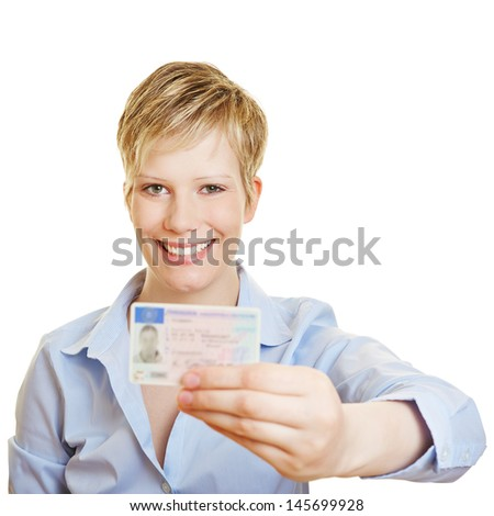 Proud young woman showing off her new drivers licence - stock photo