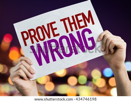 Prove Them Wrong placard with night lights on background - stock photo