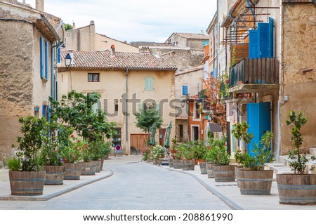 Provencal street with typical houses in southern France, Provence - stock photo