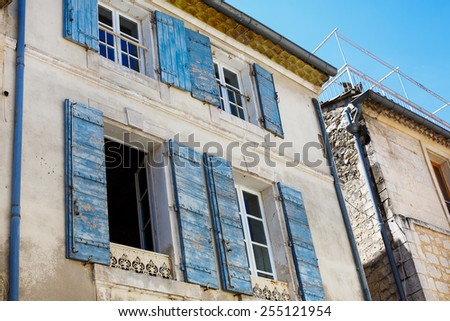 Provencal street with typical houses in southern France, Provence. Old houses and building in Arles. - stock photo