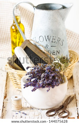 Provence lavender flowers and ceramic mortar on an old wooden board. - stock photo