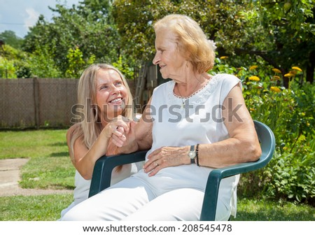 Providing care and support for elderly  - stock photo