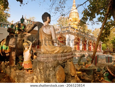 PROVINCE CHIANG MAI, THAILAND - FEBRUARY 11: Sculptures of gods and mythical creatures in temple Nantharam in province Chiang Mai, Thailand, February 11, 2014. Afterlife Scene - stock photo