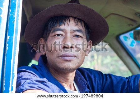 PROVINCE CHIANG MAI, THAILAND - FEBRUARY 2: Thai farmer after a hard day going home. Province of Chiang Mai, Thailand, February 2, 2014.