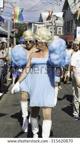 Provincetown, Massachusetts, USA-August 20, 2015: Drag queens walking in the 37th Annual Provincetown Carnival Parade in Provincetown, Massachusetts.