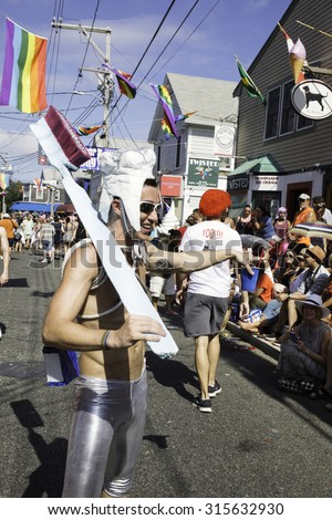 Provincetown, Massachusetts, USA-August 20, 2015: People walking in the 37th Annual Provincetown Carnival Parade in Provincetown, Massachusetts.