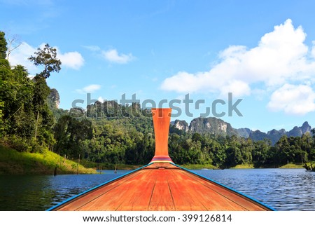 Prow of long tail boat on the lake. - stock photo