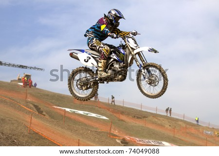 PRUNDU, ROMANIA - MARCH 26 - Pana Ciprian participates in the Motocross Championship on March 26, 2011 in Prundu, Romania.