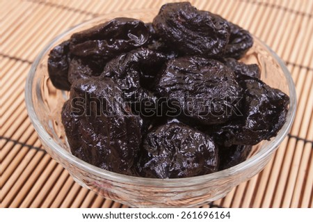 Prunes in the glass bowl - stock photo