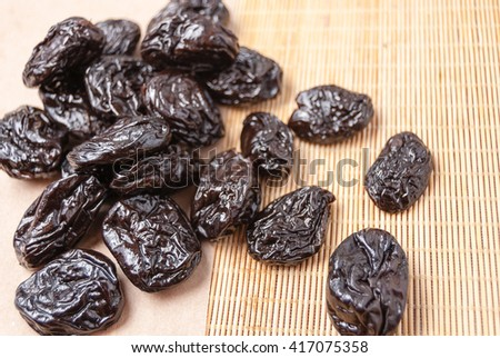 prunes on a mat - stock photo