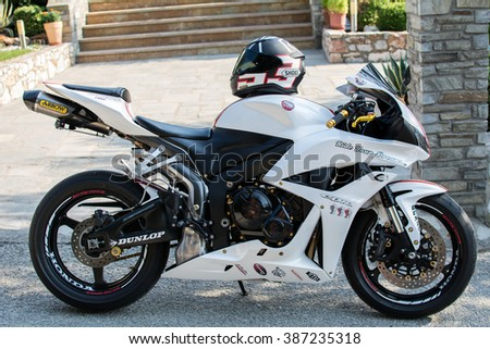 Psakoudia, Greece - August 12, 2015: Honda 2007 CBR 1000RR motorcycle, photo shot outdoors on a parking lot. Sunny day, close up in black and white.