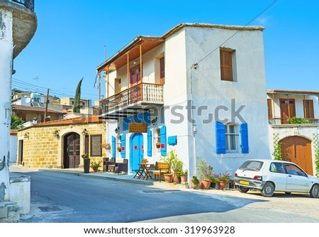 PSEMATISMENOS, CYPRUS - AUGUST 4, 2014: The small family tavern located on the central village street and offers local cuisine and vine, on August 4 in Psematismenos, Cyprus.