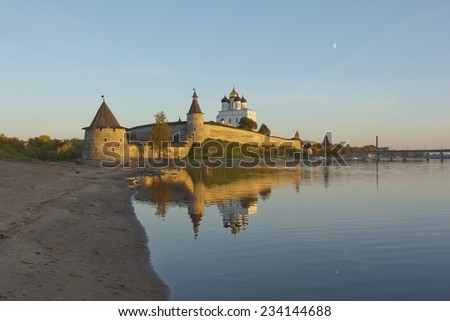 Pskov Kremlin and its reflection on a sunny autumn day