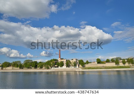 PSKOV, RUSSIA - MAY 17, 2016: Embankment of Naval glory on the Velikaya river under beautiful clouds