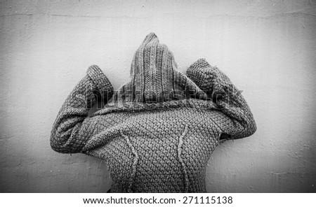 Psychiatric girl covered in city street, sick - stock photo