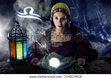Psychic or fortune teller with crystal ball and horoscope zodiac sign of Libra, birthdays of September to October. The image depicts astrology in a mystical, esoteric or magical theme composite.