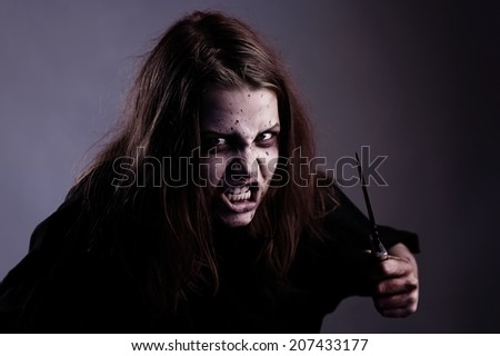 Psycho girl possessed by a demon with knife