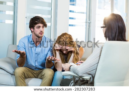 Psychologist helping a couple with relationship difficulties in the office