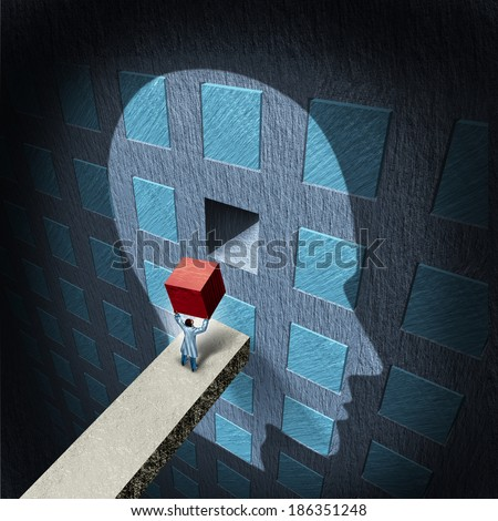 Psychology therapy concept as a doctor holding a red block to repair a compartmentalized human brain as a mental health icon for psychiatry or neurology treatment by a surgeon or research scientist. - stock photo