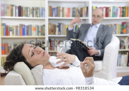 Psychotherapy: Psychologist and patient at office - stock photo
