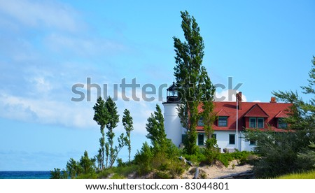 Pt. Betsie lighthouse, lake Michigan, with trees and water