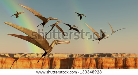 Pterodactyl - A flock of Pterodactyls fly out of a canyon looking for new prey to eat. - stock photo