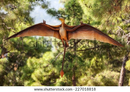 Pterodactyl - prehistoric era wing dinosaur flying at forest - stock photo
