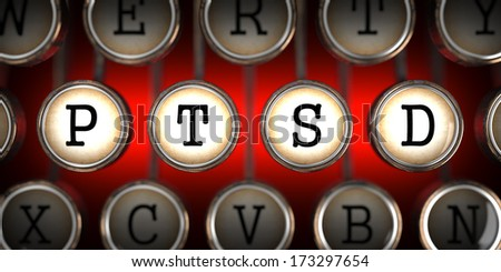 PTSD on Old Typewriter's Keys on Red Background. - stock photo