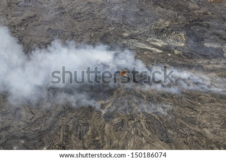 Pu'u O'o vent with visible lava and gas emissions. The Pu'u O'o vent is situated on the east rift zone of Kilauea Volcano and  has been continuously erupting since 1983. Hawaii Volcanoes National Park - stock photo