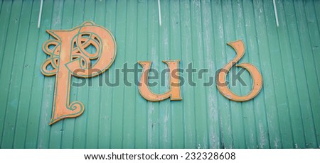 Pub text  on a wooden wall / vintage background