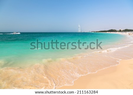 Public beach with turquoise water in Dubai, UAE - stock photo