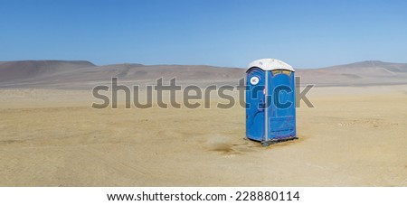 Public bio toilet in the desert - stock photo