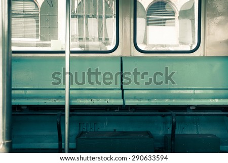 Public bus seat bench and windows - stock photo