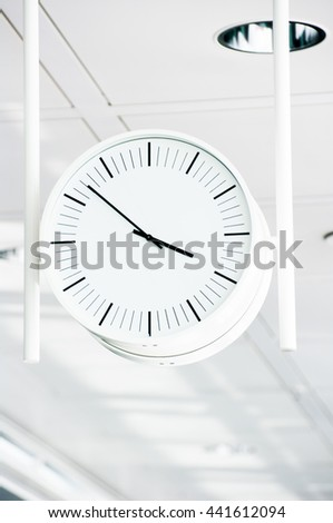 Public clock In a airport terminal - stock photo