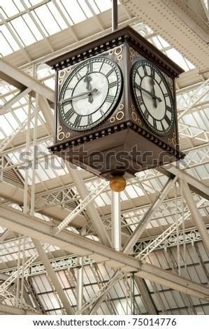 Public clock in cast-iron station in Glasgow, Scotland. - stock photo