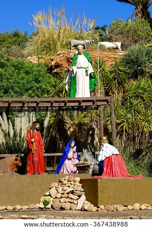 public creche with, Mary, Josef, a king, an angel, some animals  - stock photo