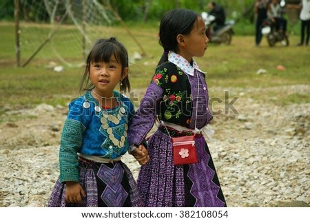 Public event: AUGUST 2015 - NORTH VIETNAM: Little girls playing during Love Market festival - an annual event where ethnic minority people meet and try to find their life partners